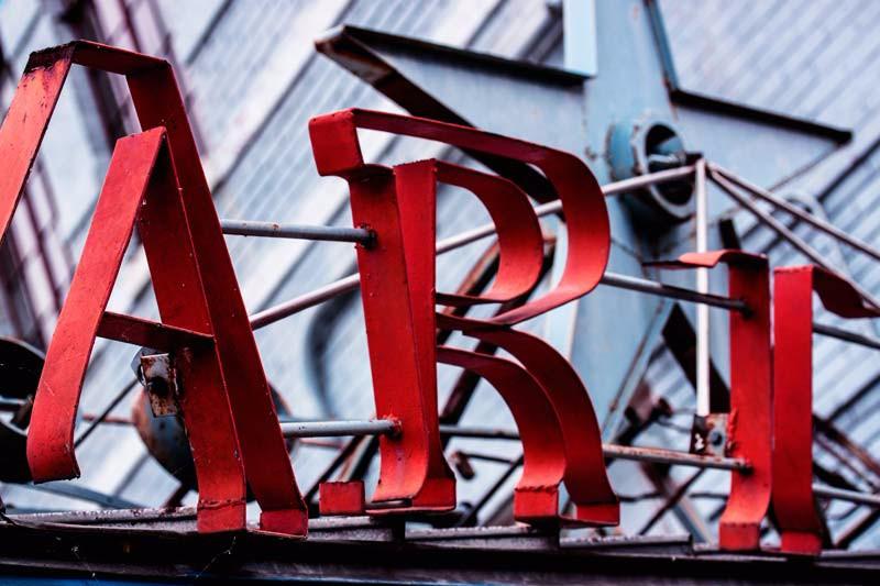 Red Art Sign at Blue Star Art