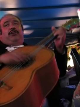 A mariachi strums his guitarrón mexicano at la Fogata in San Antonio, TX