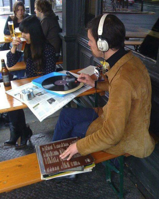 Hipster with a Record Player